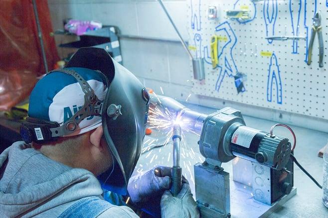 06 Hand Welding Muffler Inlet.jpg